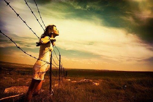 woman-barb-wire-landscape