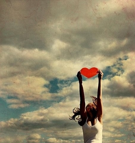 woman-catching-heart-sky